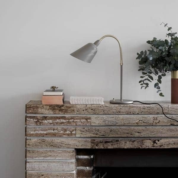 La Collection de luminaires BELLEVUE (applique, lampe de bureau et lampadaire) créée par Arne Jacobsen en  Design intemporel.